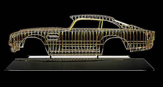 aston martin db5 scale gold sculpture