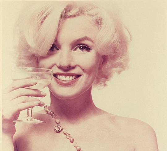 Marilyn Monroe with a wine glass in hand
