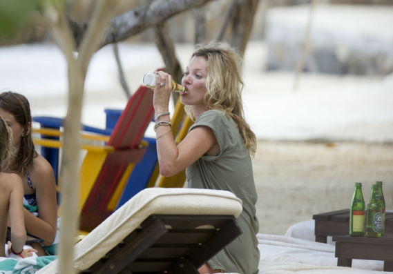 Kate Moss refueling herself by a chilled beer