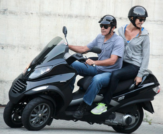 George Clooney and Stacy Keibler enjoys the scooter ride