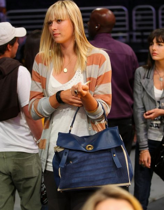 No Image Maria carries a Yves Saint Laurent large Muse Two Top Handle Bag in croco embossed Suede.