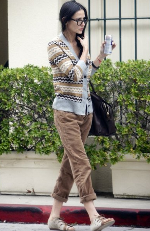 Demi Moore was spotted recently flaunting a fall 2011 collection bag by Yves Saint Laurent.