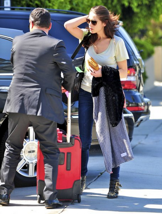 Ashley Greene has chosen to dump higher heeled pumps in favor of a more street friendly flat studded boots from Chloe.