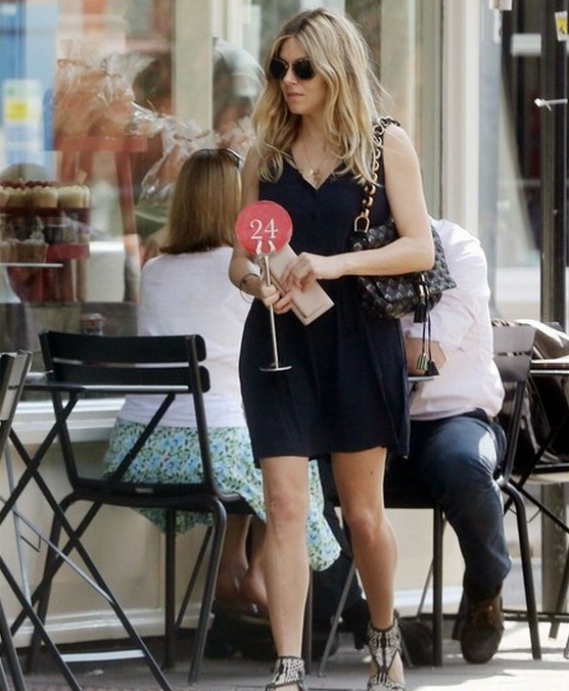 The actress was photographed donning her sunglasses while shopping.