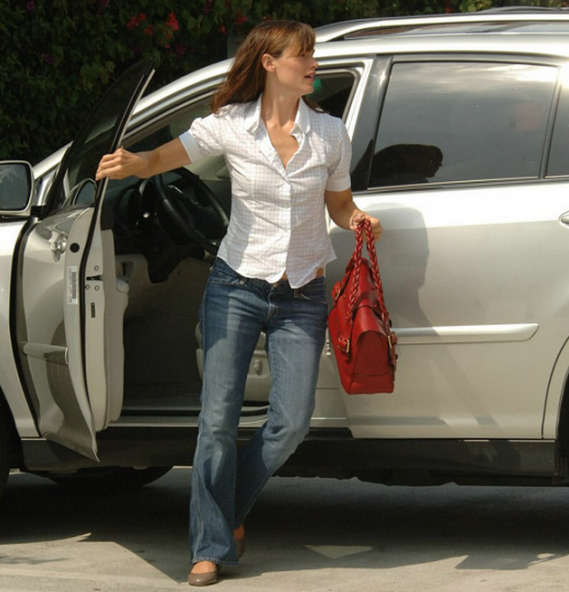 Jennifer loves driving her metallic gray Lexus RX400h.