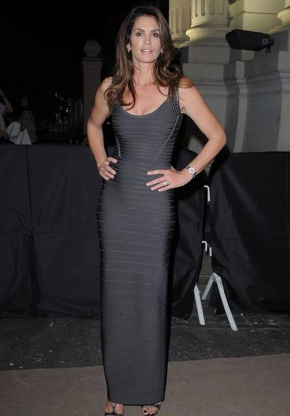 Cindy Crawford was recently spotted wearing a sleeveless bandage gown from Herve Leger while attending marriage reception ceremony of a close friend.