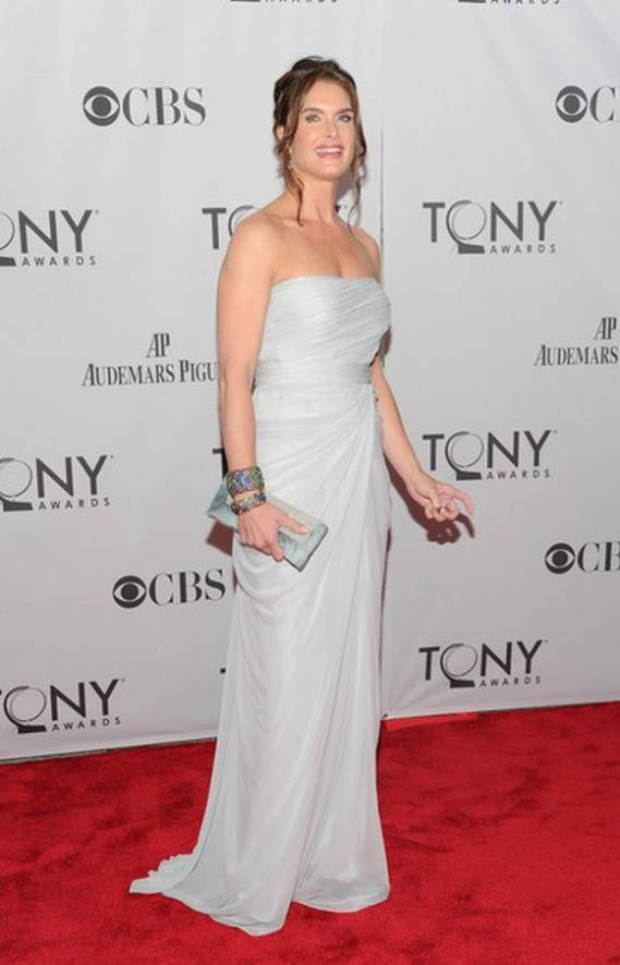 At the Tony Awards, as model and actress, Brooke Shields posed for the cameras, the 'peacock' bangles from Carolyn Rodney were conspicuous by their glitter on her wrists.