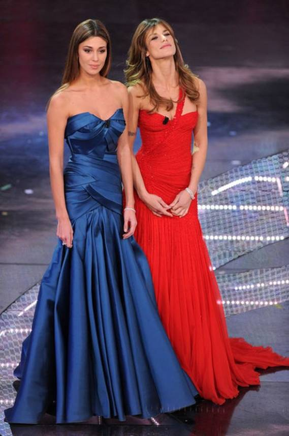 When given the chance to host the 2011 San Remo festival at the Ariston Theater, Ms.Canalis picked up a stunning, red chiffon Atelier Versace, one-shoulder gown.