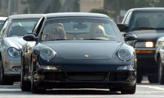 Porsche 911 Carrera is one of her favorite car's as she is frequently seen driving it.