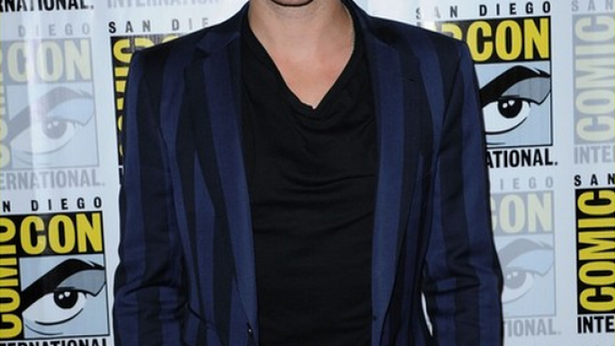 Ian flaunted his designer navy blue wide-striped woolen suit at a prestigious event.