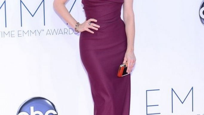 The actress flaunted her designer clutch to the red carpet of the 2012 Emmy Awards.