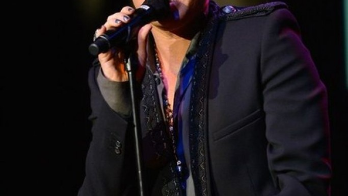 Lambert was snapped wearing the embroidered jacket at one of his performances in California on March 2012.