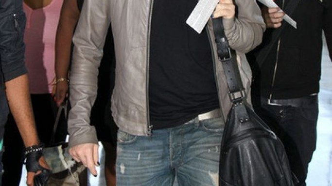 Adam was photographed wearing the slim jeans on his way to the airport.