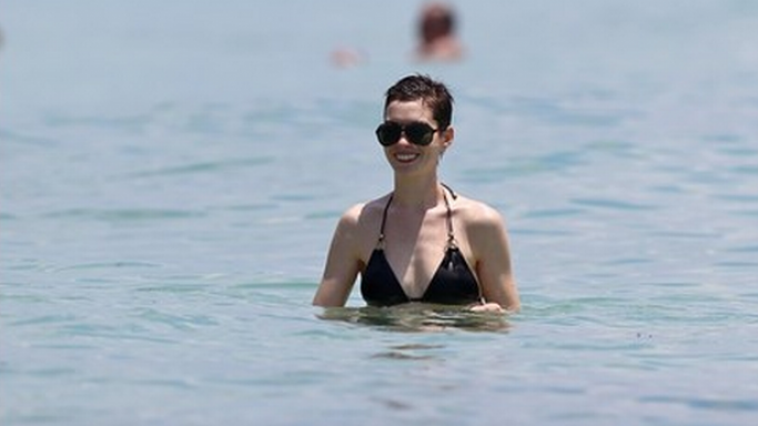 Hathaway was spotted flaunting Vitamin A Gold Swimwear Cosmo Deluxe on her beach outing in Miami, Florida.