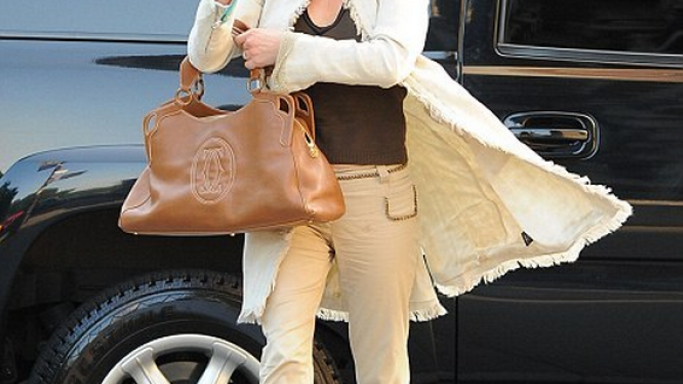 Miss Jones often flaunts her luxurious brown Marcello De Cartier handbag.