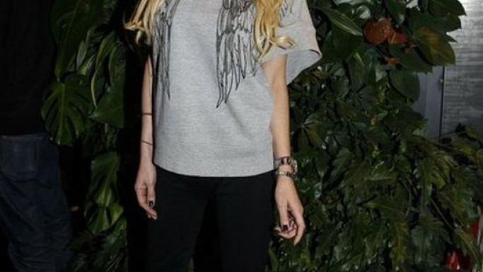 Tara Reid was spotted wearing Sergio Rossi half cage platform sandals while attending the Flagship Opening ceremony in Paris, France