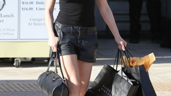 The artist wore the fashionable shorts while shopping at Barney's on September 2012.