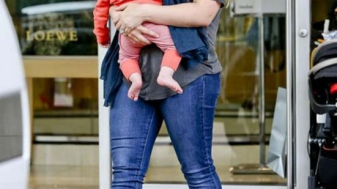 Walking out of Neiman Marcus, carrying her baby, Ms.Duff's feet were covered in booties from Rag & Bone.